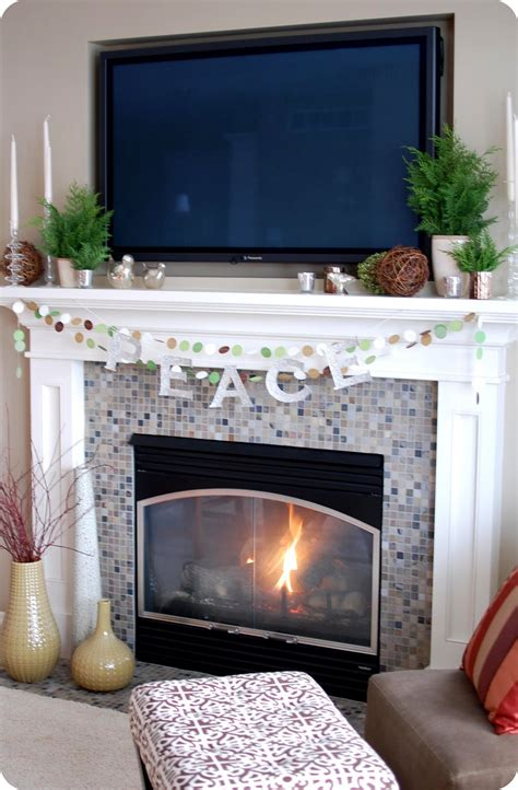 Decorating Fireplace Mantel With Tv Above by 33 Shades Of Green Decorating Around The Tv