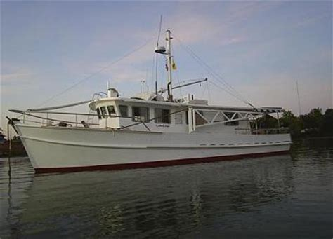 a small motor boat travels 10 mph trawler conversion cruising under power south east asia