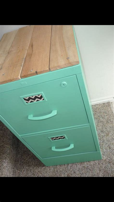 Upcycle an old filing cabinet. Like the idea to add wood