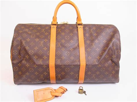 louis vuitton monogram leather brown dufflegym bag