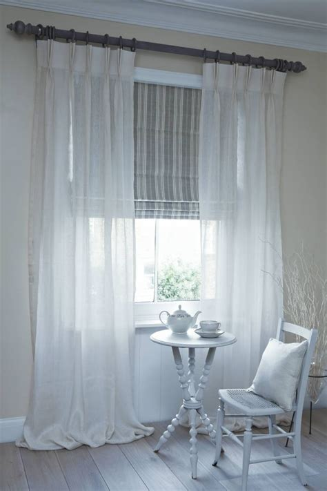 neutral bedroom curtains dublin roman blind with clare voile curtains on pole