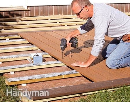 wood deck installation how to build a deck a concrete patio the family
