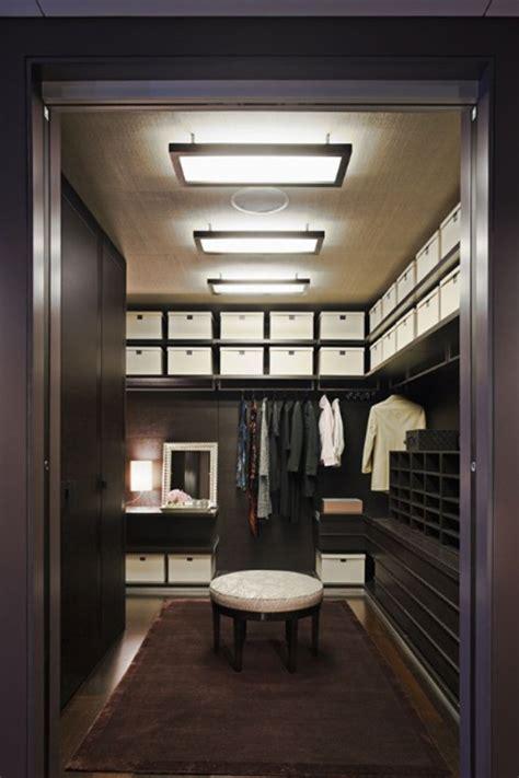 masculine dressing room dark wood  white pops  ottoman  storage boxes chrome framed