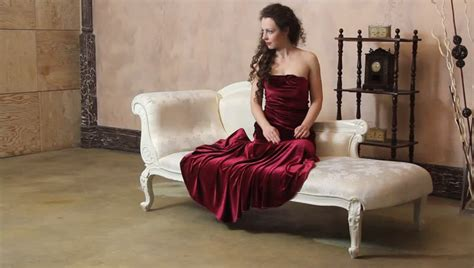 the armchair sex position sexy woman in red dress sitting on the floor by the