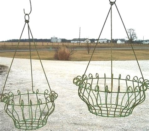 Wrought Iron Hanging Planters by Wrought Iron Georgian Hanging Planter Basket In 2 Sizes