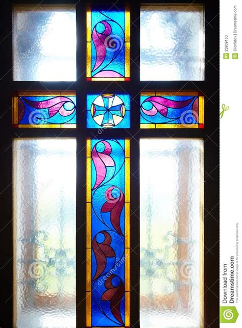 stained glass cross l catholic cross on the window stained glass stock photo