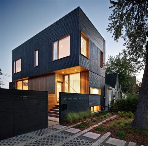Complements Home Interiors by Black Siding With Natural Wood Accents For This Toronto