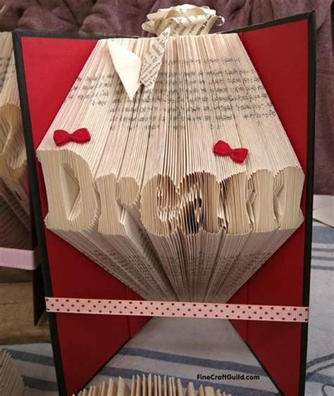 how to fold book pages into letters recycled book