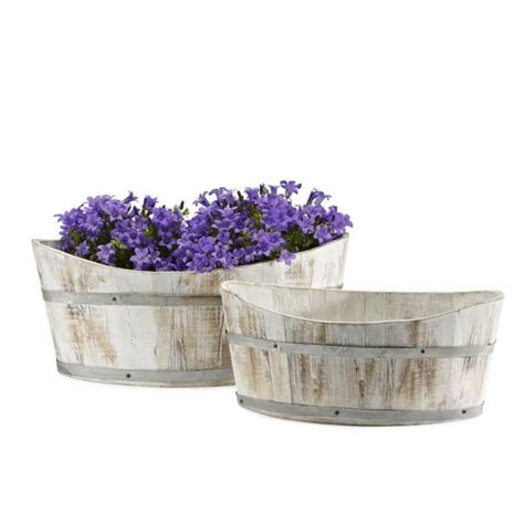 white washed boat shaped planters by garden selections