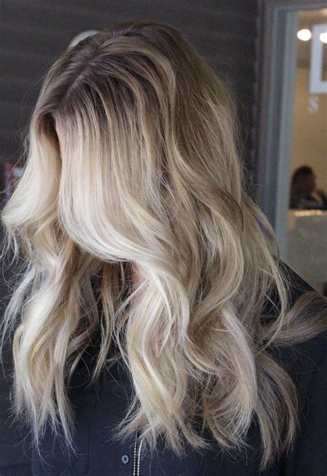 pics of darker hair roots icy blonde balayage with dark roots