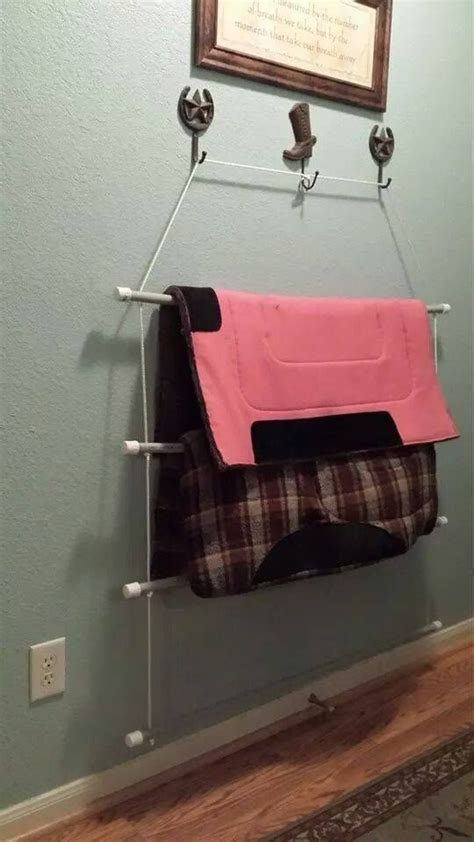 pink plastic blanket storage ideas organization and diy portable blanket rack made with pvc pipe and rope