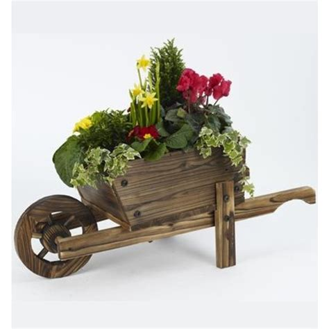 Decorative Wooden Planters by Wooden Wheelbarrow Planter The Garden Factory