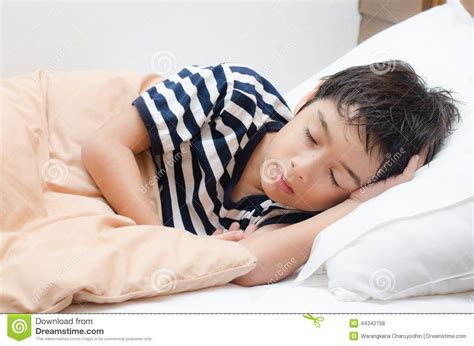 boys in bed little boy sleeping on bed stock photo image 44342758