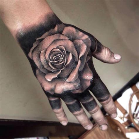 Black And Grey Rose Tattoo On Hand | 50 amazing rose hand tattoos