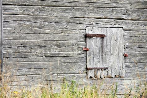 Log Barn Plans Old Grey Barn Wall Made Of Logs With Closed Door And