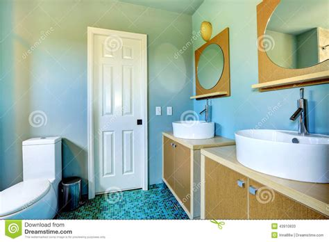 home interior bathroom mirror and sink stock photo image modern blue bathroom interior with round mirror royalty