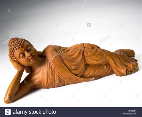 reclining buddha images a wooden statue of a reclining buddha stock photo royalty