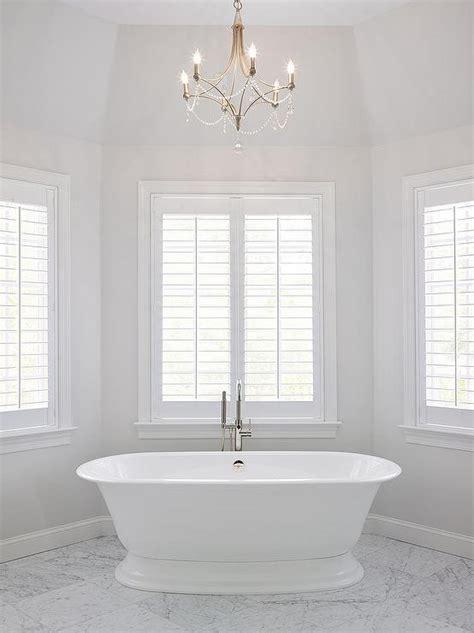bathroom bay window master bath bay window tub under chandelier transitional