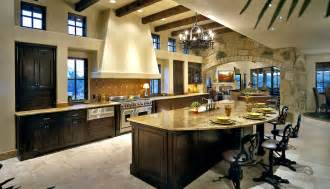 Circular Kitchen Island island is semi circular with seating on the outside facing the kitchen