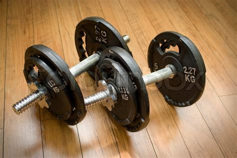 free weights sitting on a wood floor the