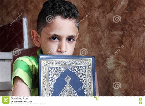 a muslim boy books arab muslim child with koran holy book stock photo image
