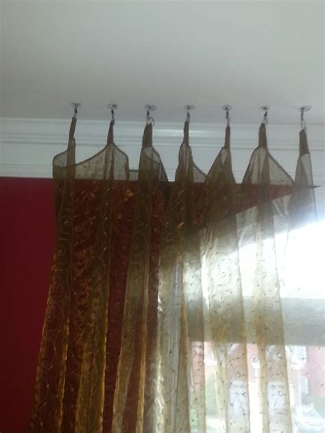 how to hang curtains from the ceiling hanging curtains from ceiling abode pinterest