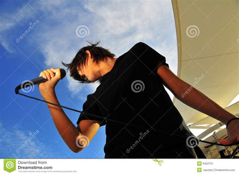swinging generation rock star swinging his hair in motion stock image image