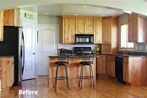 white painted kitchen cabinet reveal with before and after