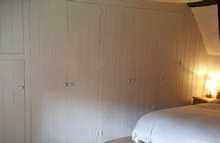 wallpaper for uneven walls uk painted fitted wardrobe for old cottage with sloping floor