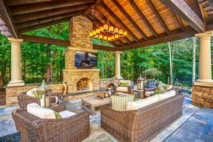 stone patio with outdoor kitchen hot tub and koi pond the great room design aesthetic one of comfort and quiet