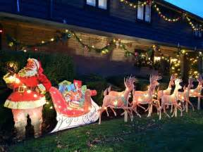 Outdoor lighted holographic santa and reindeer christmas sleigh yard