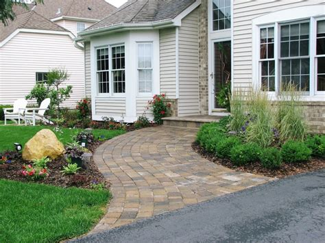 curved sidewalk in front of side entry garage love it paver walkway walkways and entrance on pinterest