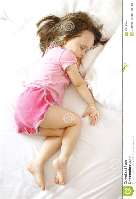 baby sleeping in bed baby sleeping peacefully in a bed stock photo image 30879400