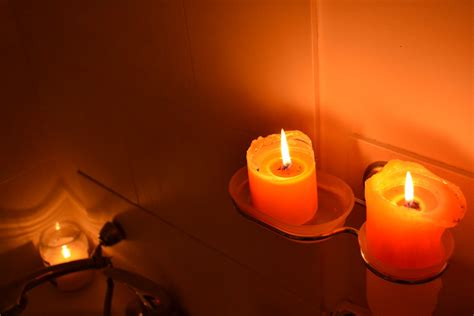 bathroom candles blueberry fingerprints candles casting shawdows in the