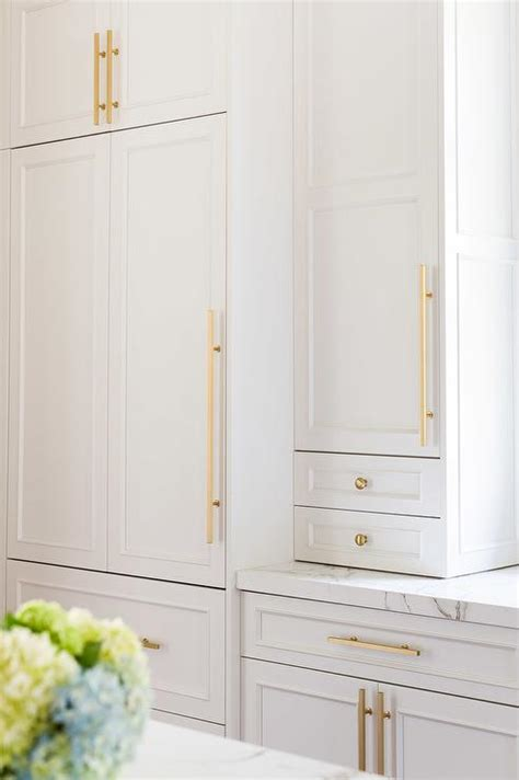 Long Kitchen Cabinets Alyssa Rosenheck White Kitchen Cabinets With Brass Knobs