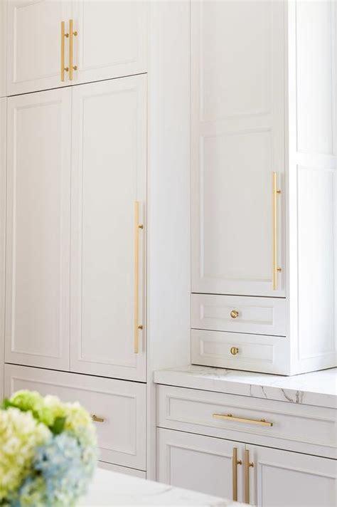 Alyssa Rosenheck: White Kitchen Cabinets with Brass Knobs