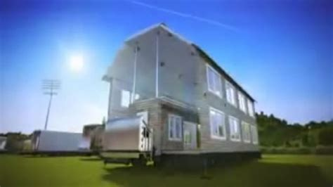 shipping containers fold out into two story houses in this