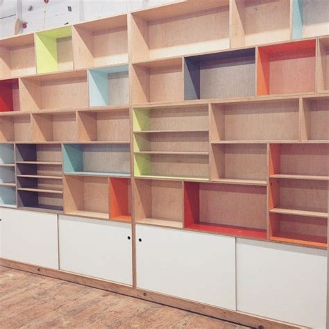 custom maple plywood bookcase with a plethora of color