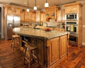 Kitchen Island With Cabinets thick granite topped kitchen island in wooden cabinet kitchen
