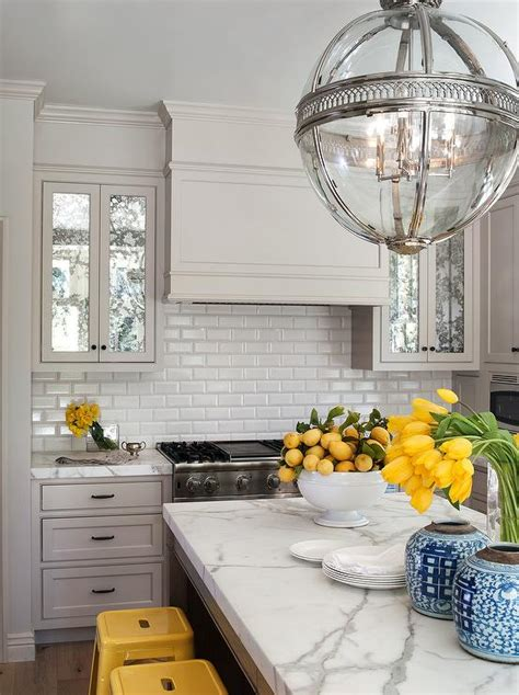 yellow subway tile backsplash yellow and gray kitchen transitional kitchen
