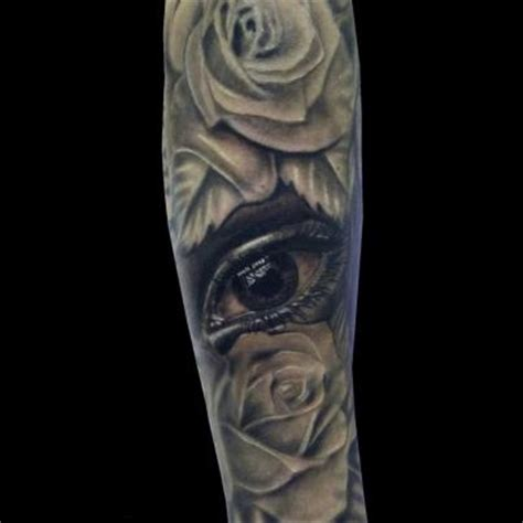 rose eye tattoo grey ink 3d roses and eye on sleeve tattooshunt