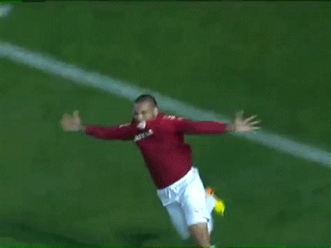 gif format player soccer player scores first goal gets injured celebrating