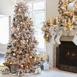Artificial flocked christmas tree decorated with metallic copper
