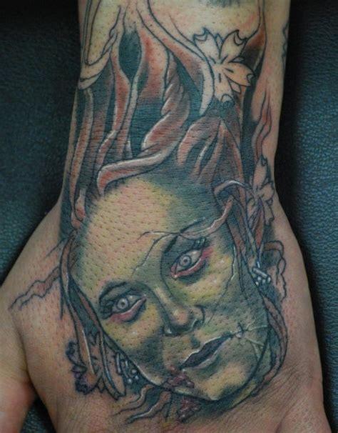 zombie tattoo on the hand tattooimages biz zombie girl head tattoo tattooimages biz