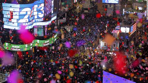during new year confetti is dropped on revelers at midnight during new