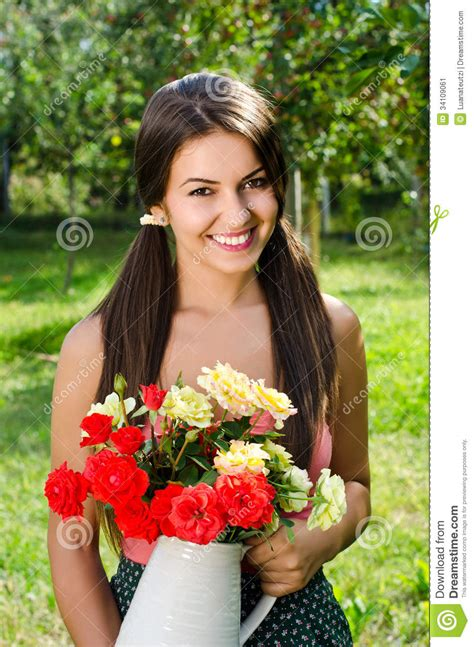 beautiful woman   garden  flowers stock image