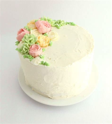 how to decorate cake with fresh flowers cake decorating buttercream flower cake the simple sweet life