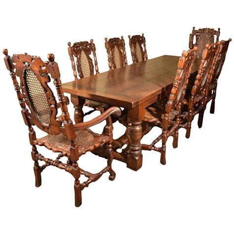 solid oak refectory dining table 8 carolean chairs