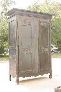 1950s ebonized wood distressed armoire at 1stdibs