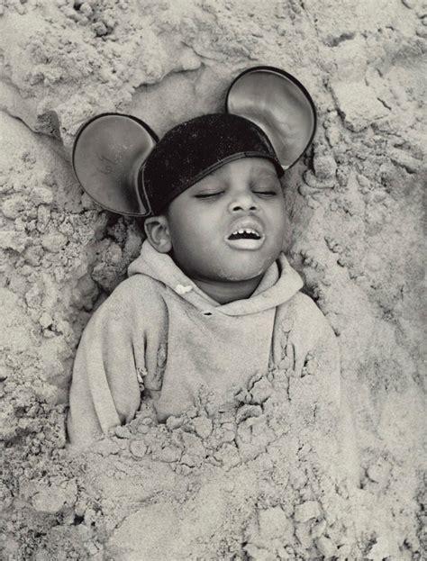 child s child buried in sand 1968 photos artist